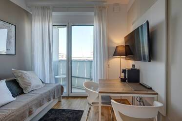 FIRST OCCUPANCY: Modern 1-room studio with concierge service in Munich-Riem