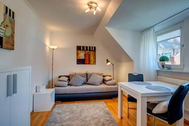 Living in the center of historic Munich: Beautifully furnished 1,5-room attic apartment
