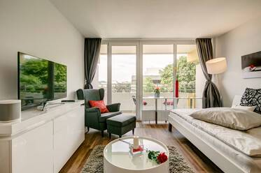 Modernly furnished apartment with balcony